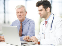 Male doctor and his patient Royalty Free Stock Photo