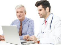 Male doctor and his patient Stock Images