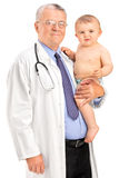 A male doctor holding a baby boy Royalty Free Stock Photo
