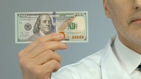 Male doctor holding banknote dollar, expensive medication, health insurance. Stock footage stock footage