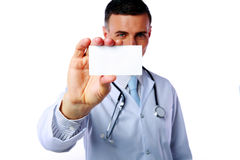 Male doctor holding blank card Royalty Free Stock Image