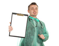 Male doctor holding blank clipboard Stock Photography