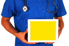 Male doctor holding blank digital tablet isolated on white backg Stock Photo