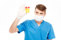 Male doctor holding bottle of urine sample Stock Photography