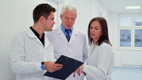 Male doctor holding clipboard in his hand stock footage