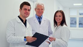 Male doctor holding clipboard in his hand stock photo