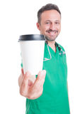 Male doctor holding a coffee to go cup Royalty Free Stock Photo