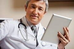Male Doctor Holding Digital Tablet Stock Image
