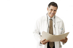Male doctor holding file, smiling, portrait, cut out Royalty Free Stock Photography