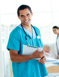 Male doctor holding a medical clipboard Stock Photos