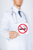 Male doctor holding no smoking sign Stock Images