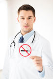 Male doctor holding no smoking sign Royalty Free Stock Images
