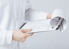 Male doctor holding prescription paper in hand Royalty Free Stock Photography