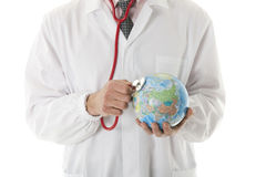 Male doctor holding stethoscope Royalty Free Stock Photos