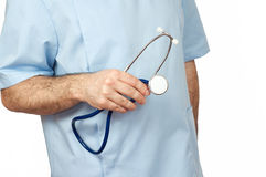 Male doctor holding a stethoscope, isolated Royalty Free Stock Photo
