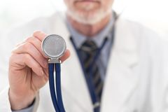 Male doctor holding stethoscope stock photography
