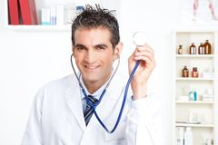 Male Doctor Holding Stethoscope Royalty Free Stock Photography