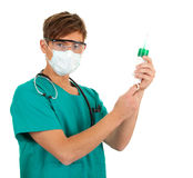 Male doctor holding a syringe Stock Photo