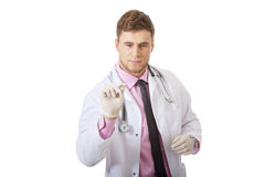Male doctor holding a syringe. Royalty Free Stock Photo