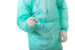 Male doctor holding a syringe. Stock Photos