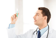 Male doctor holding syringe with injection Stock Photography