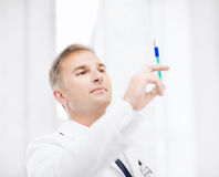 Male doctor holding syringe with injection Royalty Free Stock Photos
