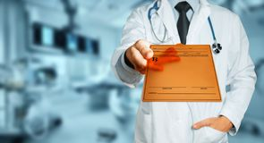 Male Doctor Holding Tablet With Diagnosis, Prescription Or Medical Data. Healthcare Insurance Medicine Concept. A male doctor in a white lab coat with a stock image
