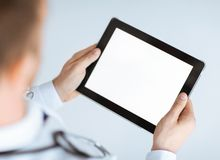 Male doctor holding tablet pc Stock Image