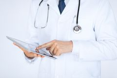 Male doctor holding tablet pc Royalty Free Stock Image