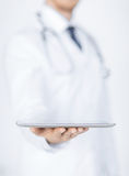 Male doctor holding tablet pc Stock Photo