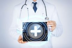 Male doctor holding tablet pc with medical app Royalty Free Stock Photos