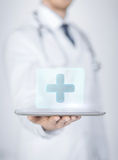Male doctor holding tablet pc with medical app Royalty Free Stock Photo