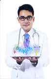 Male doctor holding a tablet Stock Photos