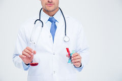Male doctor holding tube with liquid Stock Images