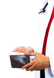 Male doctor holding a wallet and pulling out a card. A cropped image of a male doctor holding a wallet and pulling out a card isolated on white background royalty free stock photo