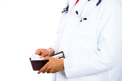 male doctor holding a wallet and pulling out a card Stock Photo