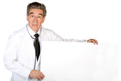 Male doctor holding a white banner Stock Images