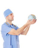 Male doctor holds world globe in his hands. Male doctor holds planet earth in his hands, isolated on white stock images
