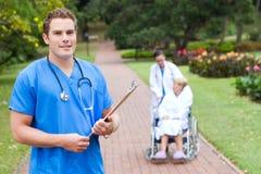 Male doctor in hospital backyard royalty free stock photo