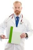Male Doctor with Information. Male Doctor pointing to a brochure, leaflet or information.  Replace with your own brochure or add text Stock Photos