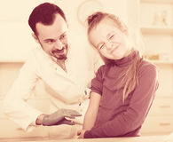 Male doctor injecting little patient Royalty Free Stock Image
