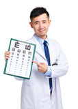 Male doctor keeping optometry chart Royalty Free Stock Photos
