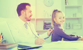 Male doctor and little girl Royalty Free Stock Photography