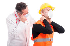 Male doctor looking at constructor back neck problem Royalty Free Stock Images