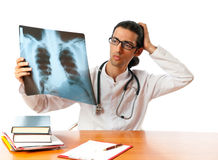 Male doctor looking at x-ray Stock Image