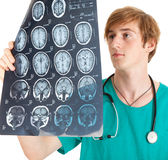 Male doctor looking at tomography brain Stock Images