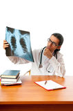 Male doctor looking at x-ray Royalty Free Stock Photography