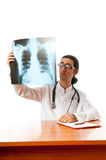 Male doctor looking at x-ray Royalty Free Stock Images