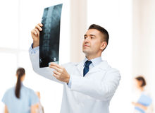 Male doctor looking at x-ray in hospital Royalty Free Stock Photo