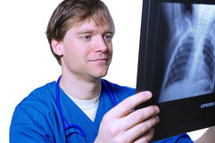 Male doctor looking at xray Stock Images
